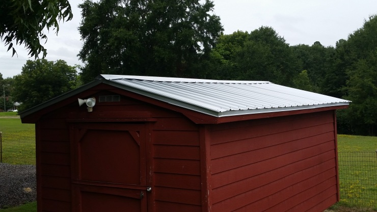 upgrade an old storage building with a new roof