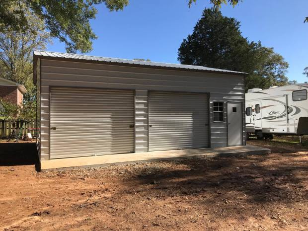 gray garage with 2 doors side entry